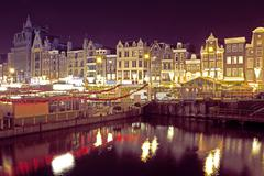 citsy csenic from amsterdam in the netherlands by night - stock photo