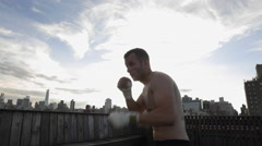 Boxer Sparring Sunset Boxing Throwing Punches NYC Manhattan Skyline 4K Stock Footage