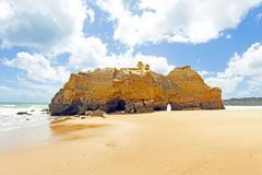 Natural rocks at praia da rocha in the algarve portugal Stock Photos
