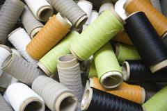 Recyclable composite textile fabrication department of factory, reels of excess - stock photo