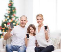 happy family with smartphones - stock photo