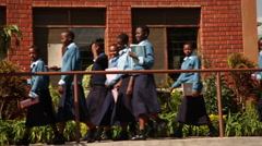 Girls Walking to Class, Tanzania, Africa - stock footage
