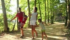 Family happy and healthy enjoying day out in nature Stock Footage