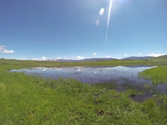 Sunny Mountains, Clouds & Lake 3k Time Lapse Stock Footage