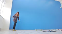 girl riding a skateboard in the background of the blue wall in the Studio - stock footage