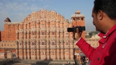 Man shoots Hawa Mahal (Palace of winds) on the camera Stock Footage