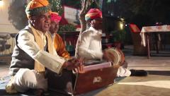 Indian street musicians sing the song - stock footage