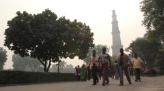People come out of Qutub Minar Stock Footage