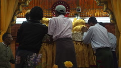 Buddhist Devotees at Hpaung Daw U Pagoda, Inle Lake, Shan State, Myanmar Stock Footage