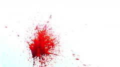Blood Spatter against a white surface 4K Stock Footage