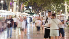 HD time lapse panning across the busy La Rambla shopping street in Barcelona - stock footage