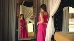 Woman checking her appearance in front of the mirror HD Stock Footage