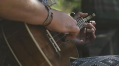 Woman Playing Ukelele close Stock Footage