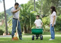 Family doing yardwork - stock photo