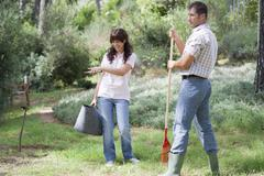 Father and daughter working together in garden - stock photo