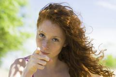 Young woman with look of reproach pointing finger at camera Stock Photos