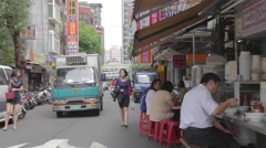 Day - taiwan people eat lunch with traffic Stock Footage