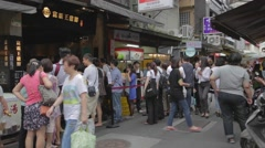 Large crowd lines up for lunch at taiwan restaurant Stock Footage