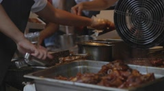 Man slices and dishes taiwan pork knuckle Stock Footage