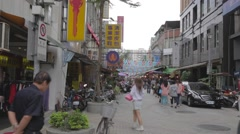 Main road leading into siping market Taipei - people in a rush Stock Footage