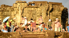 Time Lapse - Tourists at Ancient Temple Waiting for the Sunset - Angkor Wat - stock footage
