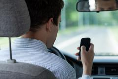 Driver using mobile phone Stock Photos