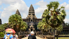 Zoom Out - Tourists at Main Temple - Angkor Wat Temple Complex Cambodia - stock footage