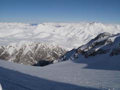Snow covered mountain peaks in the alps Kuvituskuvat