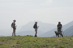 Family hiking on mountain - stock photo