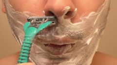 4K Young Man Shaving Stock Footage