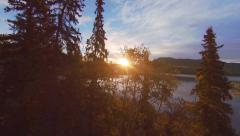 Birch Forest Sunrise Aerial over Lake with Highway Stock Footage