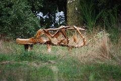 Wooden sculpture art exhibit in a wooded area Stock Photos