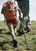 Hikers, child using walking sticks, rear view Stock Photos