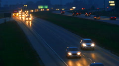 Long Line of Cars on Wet Highway At Night - stock footage