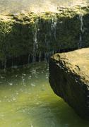 Water running over stones blocks, close-up Stock Photos