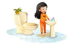 A cute little girl washing her hands Stock Illustration