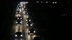 Long Line of Cars on Wet Highway At Night Stock Footage