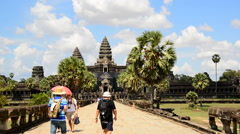 Tourists Walking Towards the Main Temple - Angkor Wat Temple Complex Cambodia Stock Footage
