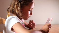 Girl playing with technology Stock Footage