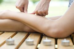 Woman receiving leg massage - stock photo