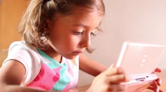 Little cute girl using console, touch screen technology Stock Footage