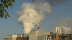 Smoke and steam discharged from a factory Stock Footage