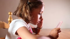 Little Girl using touchscreen technology Stock Footage