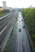 Sweden, Stockholm, traffic on street beside railway - stock photo