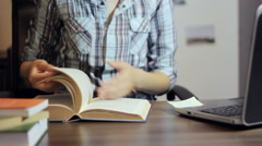 Student searching for information in a book Stock Footage