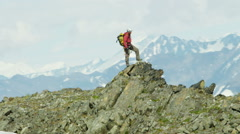 Aerial Male Climber Alaska Glacial Mountain Range Outdoors Success 4K RED EPIC - stock footage