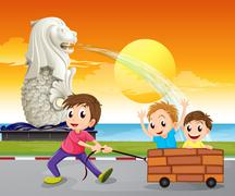 Stock Illustration of A boy pulling an improvised cart near the statue of the Merlion