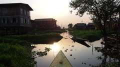 Boat Going Through Floating Village at Inle Lake, Shan State, Myanmar (Burma) Stock Footage