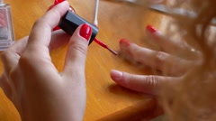 Woman Painting Nails with Red Color. Homemade Manicure. Stock Footage
