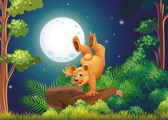 A forest with a playful bear above the rocks Stock Illustration